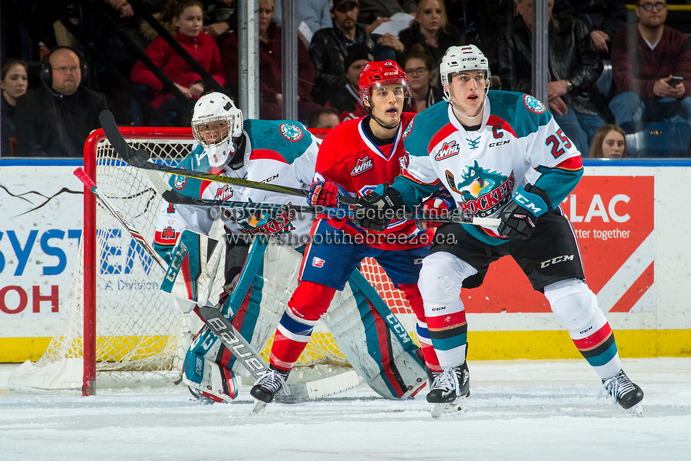 KELOWNA, CANADA - MARCH 3: Eli Zummack #29 of the Spokane Chiefs stick checks Cal Foote #25 in front of the net of James Porter #1 of the Kelowna Rockets on March 3, 2018 at Prospera Place in Kelowna, British Columbia, Canada.  (Photo by Marissa Baecker/Shoot the Breeze)  *** Local Caption ***
