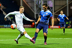 Cauley Woodrow of England U21 challenges Shane O'Neill of USA U23  - Mandatory byline: Matt McNulty/JMP - 07966386802 - 03/09/2015 - FOOTBALL - Deepdale Stadium -Preston,England - England U21 v USA U23 - U21 International