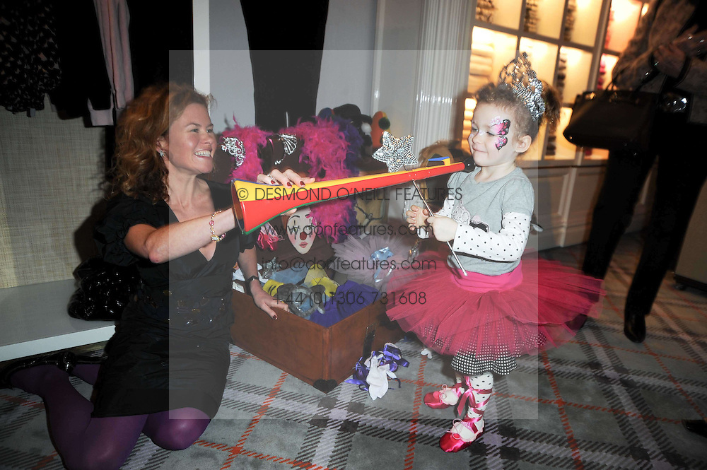 ERIN MORRIS and her daughter SKYE MORRIS at the Juicy Couture children's tea party in aid of Mothers 4 Children held at the Juicy Couture Store, Bruton Street, London on2nd December 2009.