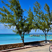 Cycling on Front Street in Cockburn Town, Grand Turk, Turks and Caicos Islands<br />