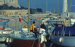 Men Talking On Sail Boat  Marina, France