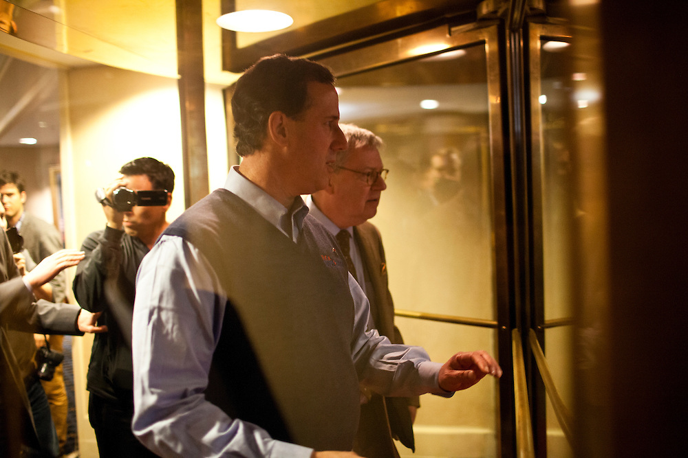 Republican presidential candidate Rick Santorum leaves a campaign event on Tuesday, January 17, 2012 in Columbia, SC.