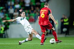 Robert Koren of Slovenia vs Timmy Simons of Belgium during friendly football match between National teams of Slovenia and Belgium, on August 10, 2011, in SRC Stozice, Ljubljana, Slovenia. (Photo by Matic Klansek Velej / Sportida)
