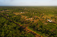 Aerial view of rural Zulu homesteads on the boundary of the Phinda Private Game Reserve, KwaZulu Natal, South Africa