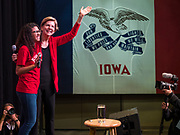 20 OCTOBER 2019 - INDIANOLA, IOWA: JAILYN SEABROOKS, President of the Simpson College student body (left), introduces US Senator ELIZABETH WARREN (D-MA) during a Warren campaign event at Simpson College in Indianola, IA. Sen. Warren is campaigning to be the Democratic nominee for the US presidency in Iowa this week. Iowa traditionally hosts the the first selection event of the presidential election cycle. The Iowa Caucuses will be on Feb. 3, 2020.                 PHOTO BY JACK KURTZ