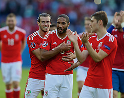 PARIS, FRANCE - Saturday, June 25, 2016: Wales' Gareth Bale and captain Ashley Williams celebrate after the 1-0 victory over Northern Ireland, sealing progression to the Quarter-Final, during the Round of 16 UEFA Euro 2016 Championship match at the Parc des Princes. (Pic by David Rawcliffe/Propaganda)