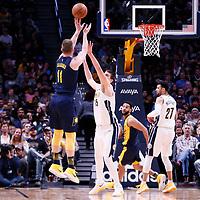 03 April 2018: Indiana Pacers center Domantas Sabonis (11) takes a jump shot over Denver Nuggets center Nikola Jokic (15) during the Denver Nuggets 107-104 victory over the Indiana Pacers, at the Pepsi Center, Denver, Colorado, USA.