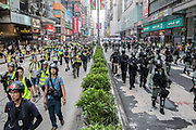 HONG KONG: 13 October 2019 <br /> Members of the press (left) follow riot police (right) during running battles between protesters and riot police today as demonstrators move into their 19th consecutive week of protests in Hong Kong. The movement's aim, which started on June 1st, originally wanted to get rid of a controversial extradition bill which has since been removed, however the protests have formed into a wider fight against police brutality and the ability to wear a mask without fear of arrest.<br /> Rick Findler / Story Picture Agency