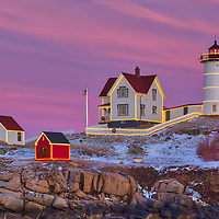 Nubble Lighthouse with Christmas Decoration taken at sunset in York, Maine. Loved watching this sunset burst into colors and capturing the Holiday Lights while the last light of the day created a beautiful sky across one of Maine's most iconic Christmas light scenes.<br />