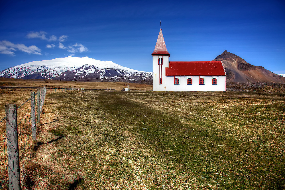 "The church at Hellnar on the Snæfellsnes peninsula in western Iceland stands before the Snæfellsjökull volcano and glacier, thought to be one of the major energy centers of earth. French writer Jules Verne chose it as the entrance in his novel ""Journey to the Center of the Earth."""