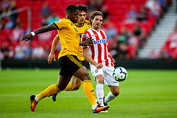 Joe Allen of Stoke City takes on Ivan Cavaleiro of Wolverhampton Wanderers - Mandatory by-line: Robbie Stephenson/JMP - 25/07/2018 - FOOTBALL - Bet365 Stadium - Stoke-on-Trent, England - Stoke City v Wolverhampton Wanderers - Pre-season friendly