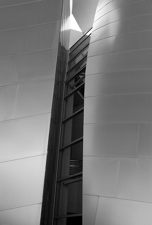 Slit window framed by two stainless steel wall segments at the Walt Disney Concert Hall in Los Angeles.
