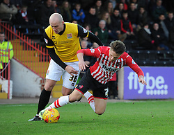 Northampton's Ryan Cresswell fouls Exeter City's Tom Nichols - Photo mandatory by-line: Alex James/JMP - Mobile: 07966 386802 - 10/01/2015 - SPORT - football - Exeter - St James Park - Exeter City v Northampton - Sky Bet League Two