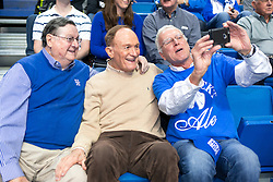Jud Chalkley, right of Lexington takes a photo with former UK head coach Joe B. Hall, left, and former LSU head coach Dale Brown during halftime. <br /> <br /> The University of Kentucky hosted the LSU Tigers, Saturday, March 05, 2016 at Rupp Arena in Lexington .