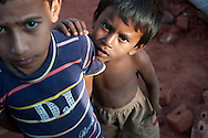 Children in a brick yard in Chittagong, Bangladesh, cannot remove their eyes from my camera.