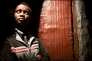 "Jananesh, 16 years old, waits customers outside her shack, in a poor red light neighborhood. She lives in a hidden way and most of the time stops the customers on the main road, to lead them in her own home. Three years before leaves her husband who abused her. The same elders of the village that gave married, gave the separation, but forced to leave home. At the age of 12 years is cheated by brokers who await the arrival of the buses in the capital, to provide fictitious jobs to young girls. Since 2004, the Ethiopian penal code forbids girls to get married before the age of 18 and punishes marriage by abduction with up to 20 years imprisonment. This is being seen as a real step forward according to a number of humanitarian agencies, but one which needs to be promoted and implemented. Addis Ababa, Ethiopia, on saturday, Febrary 21 2009.....In a tangled mingling of tradition and culture, in the normal place of living, in a laid-back attitude. The background of Ethiopia's ""child brides"", a country which has the distinction of having highest percentage in the practice of early marriages despite having a law that establishes 18 years as minimum age to get married. Celebrations that last days, their minds clouded by girls cups of tella and the unknown for the future. White bridal veil frame their faces expressive of small defenseless creatures, who at the age ranging from three to twelve years shall be given to young brides men adults already...To protect the identities of the recorded subjects names and specific places are fictional."