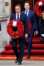 © Licensed to London News Pictures. 08/05/2015. LONDON, UK. Prime Minister David Cameron and Nick Clegg attending a service of remembrance at the Cenotaph in London marking the 70th anniversary of VE Day on Friday, 8 May 2015. Photo credit : Tolga Akmen/LNP