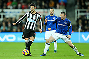 Mikel Merino (#23) of Newcastle United steps away from the challenge of Wayne Rooney (#10) of Everton during the Premier League match between Newcastle United and Everton at St. James's Park, Newcastle, England on 13 December 2017. Photo by Craig Doyle.
