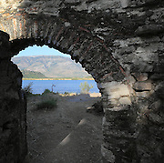 The Lake Gate or Scean Gate viewed from the inside, built 4th century BC within the Hellenistic city walls, Butrint, Chaonia, Albania. Butrint was founded by the Greek Chaonian tribe and was a port throughout Hellenistic and Roman times, when it was known as Buthrotum. It was ruled by the Byzantines and the Venetians and finally abandoned in the Middle Ages. The ruins at Butrint were listed as a UNESCO World Heritage Site in 1992. Picture by Manuel Cohen