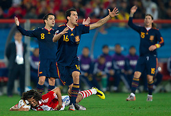 Nelson Valdez of Paraguay, Xavi of Spain, Sergio Busquets of Spain  and Sergio Ramos of Spain complain to referee during the  2010 FIFA World Cup South Africa Quarter Finals football match between Paraguay and Spain on July 03, 2010 at Ellis Park Stadium in Johannesburg. (Photo by Vid Ponikvar / Sportida)