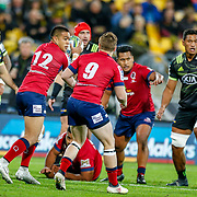 Duncan Paia'aua prepares tp ass the ball during the Super rugby union game (Round 14) played between Hurricanes v Reds, on 18 May 2018, at Westpac Stadium, Wellington, New  Zealand.    Hurricanes won 38-34.