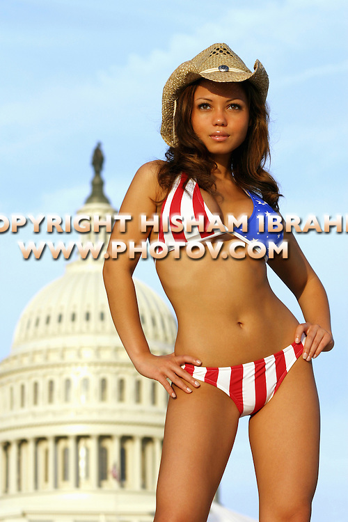 Sexy patrotic Asian woman in an American Flag bikini by the US Capitol Building, Washington DC, USA