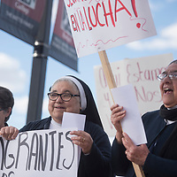Sister Lylinaa Ricaud, left and Mother Magda Garcia from Casa Reina hold signs and cheer in support of the May Day rally in support of immigrants held at the courthouse square in downtown Gallup Monday.