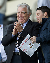 SWANSEA, WALES - Saturday, September 22, 2012: Everton's chairman and owner Bill Kenwright applauds his side off with a smile after the 3-0 victory over Swansea City during the Premiership match at the Liberty Stadium. (Pic by David Rawcliffe/Propaganda)
