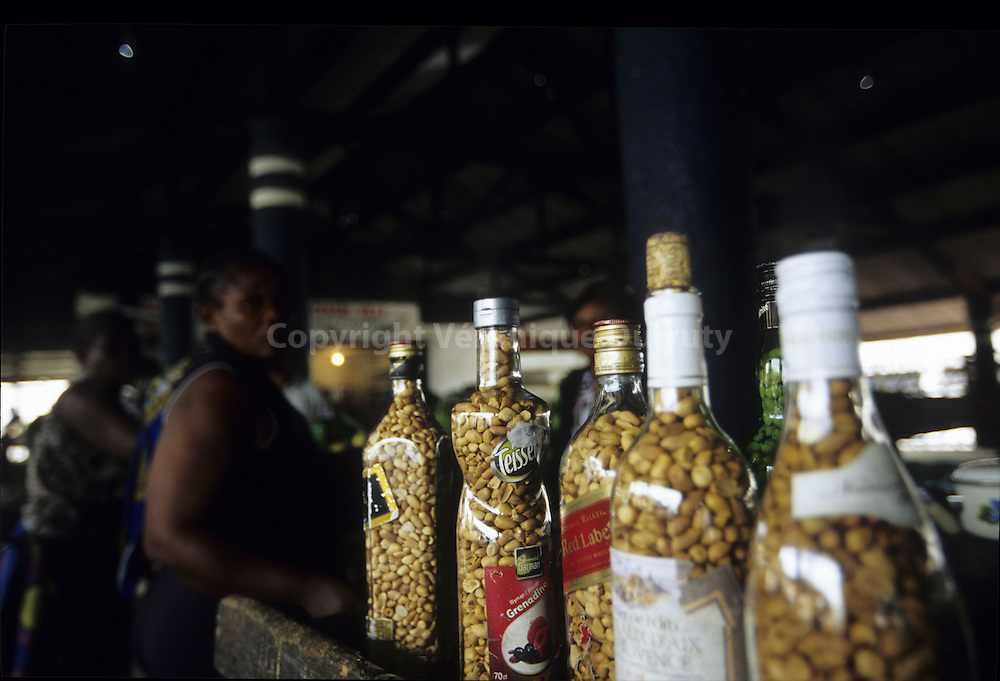 PEANUTS FOR SALE RECYCLING OLD ALCOHOL BOTTLES, BRAZZAVILLE, CONGO
