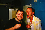 Skint Records labelmates (Midfield General) and Norman Cook (Fatboy Slim) drinking, UK, 1990's