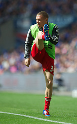 LONDON, ENGLAND - Saturday, April 14, 2012: Liverpool's substitute Craig Bellamy warms up during the FA Cup Semi-Final match against Everton at Wembley. (Pic by David Rawcliffe/Propaganda)