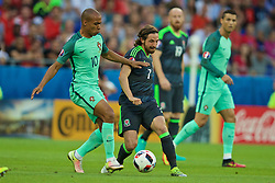 LYON, FRANCE - Wednesday, July 6, 2016: Wales' Joe Allen in action against Portugal's João Mário during the UEFA Euro 2016 Championship Semi-Final match at the Stade de Lyon. (Pic by David Rawcliffe/Propaganda)