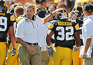September 4 2010: Iowa Hawkeyes head coach Kirk Ferentz pats Iowa Hawkeyes running back Adam Robinson (32) on the head after his 6 yard touchdown run during the second quarter of the NCAA football game between the Eastern Illinois Panthers and the Iowa Hawkeyes at Kinnick Stadium in Iowa City, Iowa on Saturday September 4, 2010. Iowa defeated Eastern Illinois 37-7.