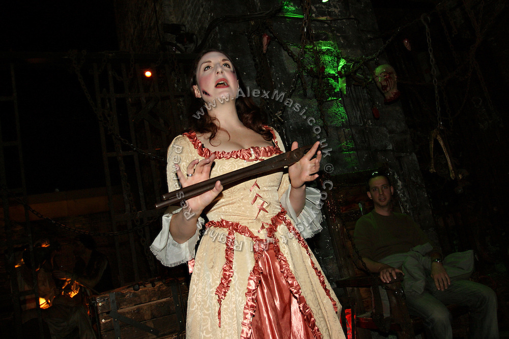 Actress during a play on medieval torture in one of the rooms inside at the London Dungeon, England, on Thursday, Oct. 12, 2006. The London Dungeon is a live theatre attraction where visitors are taken by the actors through different areas featuring the darkest parts of British history. Some of the more than 40 exhibits include 'The Great Fire of London', 'Jack the Ripper', 'Judgement Day', 'The Torture Chamber', 'Henry VIII', 'The Tower of London' and 'The French Revolution'. In 2003 a new part opened focused on the Great Plague of 1665.   **Italy Out**..