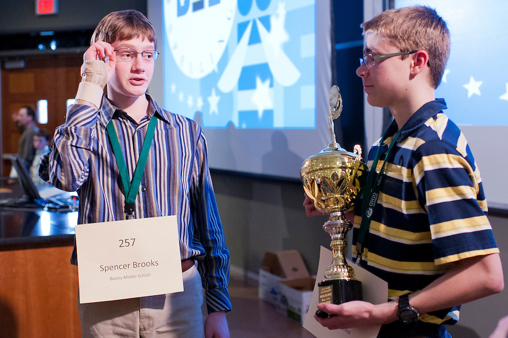 Spencer Brooks, a previous Scripps College of Communication Regional Spelling Bee winner, congratulates and gives advice to Kyle Schroeder, the 2013 Columbus Metro Area Regional winner, after the competition Saturday, March 16, 2013.