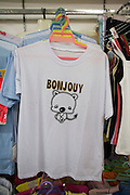 A t-shirt with a French misspelling for sale in a Chinese textile market in Hainan island. T-shirts with English phrases, or other languages, are popular in China, but often are misspelled or worded incorrectly.