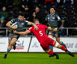 Luke Morgan of Ospreys is tackled by George Kruis of Saracens<br /> <br /> Photographer Simon King/Replay Images<br /> <br /> European Rugby Champions Cup Round 5 - Ospreys v Saracens - Saturday 11th January 2020 - Liberty Stadium - Swansea<br /> <br /> World Copyright © Replay Images . All rights reserved. info@replayimages.co.uk - http://replayimages.co.uk
