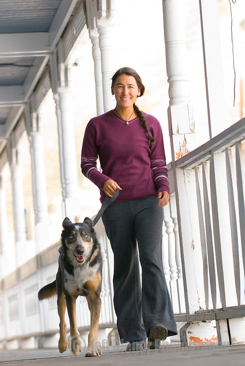 A young woman walks with her dog in downtown Jackson, Wyoming.