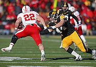November 23 2012: Nebraska Cornhuskers running back Rex Burkhead (22) gets around Iowa Hawkeyes linebacker James Morris (44) during the second half of the NCAA football game between the Nebraska Cornhuskers and the Iowa Hawkeyes at Kinnick Stadium in Iowa City, Iowa on Friday November 23, 2012. Nebraska defeated Iowa 13-7 in the Heroes Game on Black Friday.