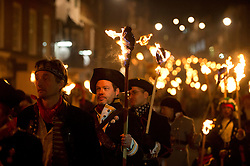 """05/11/2013 . Lewes, UK. A firework exploding. Bonfire societies parade through the streets of Lewes, East Sussex, during the traditional bonfire night celebrations. Thousands of people line the narrow streets to watch as bonfire societies parade in costume with the evening ending in the burning of the """"guy"""". Bonfire Night marks the date of the uncovering of the Gunpowder Plot in 1605 and commemorates the memory of the seventeen Protestant martyrs. Photo credit : Ben Cawthra"""