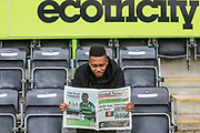 Forest Green Rovers Keanu Marsh-Brown(7) reads the local newspaper sports pages during the Forest Green Rovers Press Conference and Training session at the New Lawn, Forest Green, United Kingdom on 12 May 2017. Photo by Shane Healey.