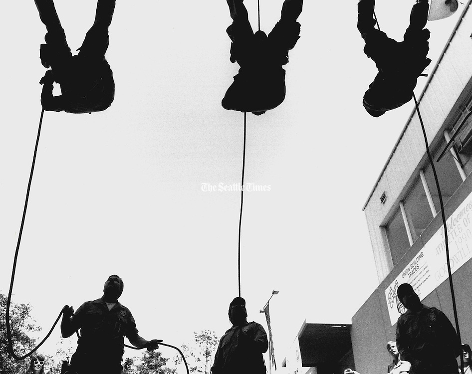 Members of the Port of Seattle Police Tactical Services Unit rappel off a building during a family day at the Port of Seattle fire police, and operations departments.  (The Seattle Times, 1990)