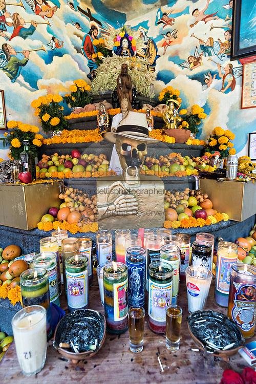 A central courtyard shrine and offerings inside the La Casa De La Santa Muerte or House of the Saint of the Dead November 1, 2017 in Santa Ana Chapitiro, Michoacan, Mexico.