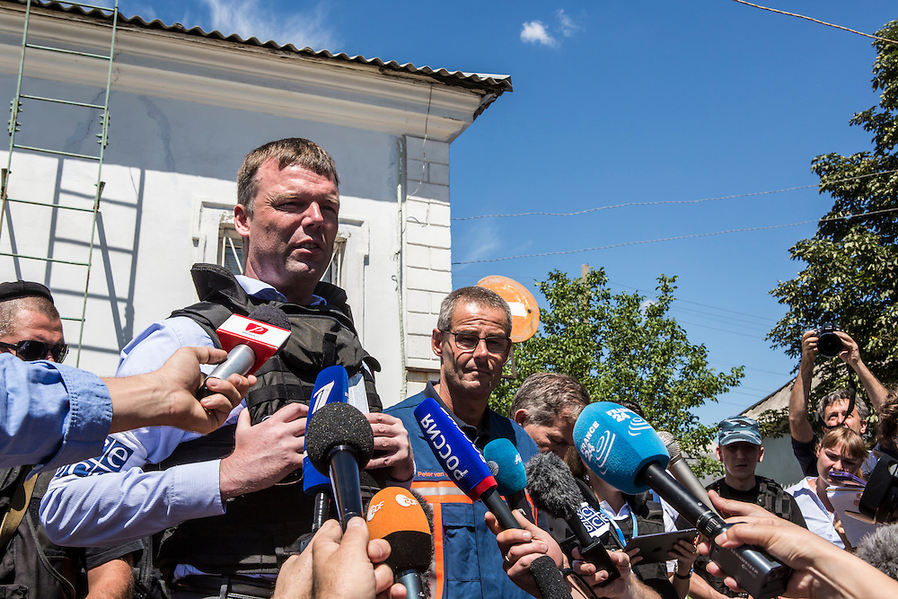 TOREZ, UKRAINE - JULY 21: Alexander Hug (L), Deputy Chief Monitor of the Organisation for Security and Cooperation in Europe (OSCE) Special Monitoring Mission to Ukraine, speaks to reporters after visiting a train containing the bodies of victims of the Malaysia Airlines flight MH17 crash on July 21, 2014 in Torez, Ukraine. Together with Dutch inspectors, the storage conditions were declared acceptable, though it is still unclear where or when the train will be moved. Malaysia Airlines flight MH17 was travelling from Amsterdam to Kuala Lumpur when it crashed killing all 298 on board including 80 children. The aircraft was allegedly shot down by a missile and investigations continue over the perpetrators of the attack. (Photo by Brendan Hoffman/Getty Images) *** Local Caption ***  Alexander Hug