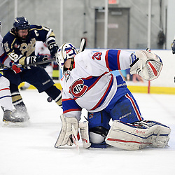 TORONTO, ON - Mar 31 : Ontario Junior Hockey League, Toronto Patriots v Toronto Jr. Canadiens, SouthWest Championship Series, Game 3. =Nathaniel Colitto #29 of the Toronto Jr. Canadiens Hockey Club tries to make the save on the Toronto Patriots goal by Louis DiMatteo #22 of the Toronto Patriots Hockey Club during the first period.<br /> (photo by Jay Johnston / OJHL Images)