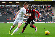 Milton Keynes Dons midfielder (on loan from Leicester City) Harvey Barnes (18) battles for possession with Shrewsbury Town defender Aristote Nsiala (22) during the EFL Sky Bet League 1 match between Milton Keynes Dons and Shrewsbury Town at stadium:mk, Milton Keynes, England on 25 February 2017. Photo by Dennis Goodwin.
