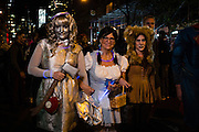 New York, NY - 31 October 2016. THree women dressed as characters from The Wizard of Oz: the tin woodsman, Dorothy, and the cowardly lion,  in the Greenwich Village Halloween Parade.