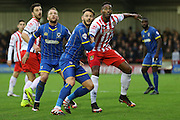 Callum Kennedy of AFC Wimbledon and Jamille Matt of Stevenage tussle during the Sky Bet League 2 match between AFC Wimbledon and Stevenage at the Cherry Red Records Stadium, Kingston, England on 12 December 2015. Photo by Stuart Butcher.