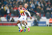 Stoke City forward Tyrese Campbell (26)  and Leeds United midfielder Adam Forshaw (4) contest a loose ball  during the EFL Sky Bet Championship match between Stoke City and Leeds United at the Bet365 Stadium, Stoke-on-Trent, England on 19 January 2019.