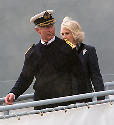 Prince Charles and Camilla depart from HMS Illustrious following their visit to Portsmouth, United Kingdom. Wednesday, 26th February 2014. Picture by i-Images